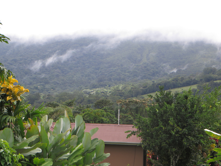 Clouds covering Arenal Volcano. View from Arenal Springs Resort.